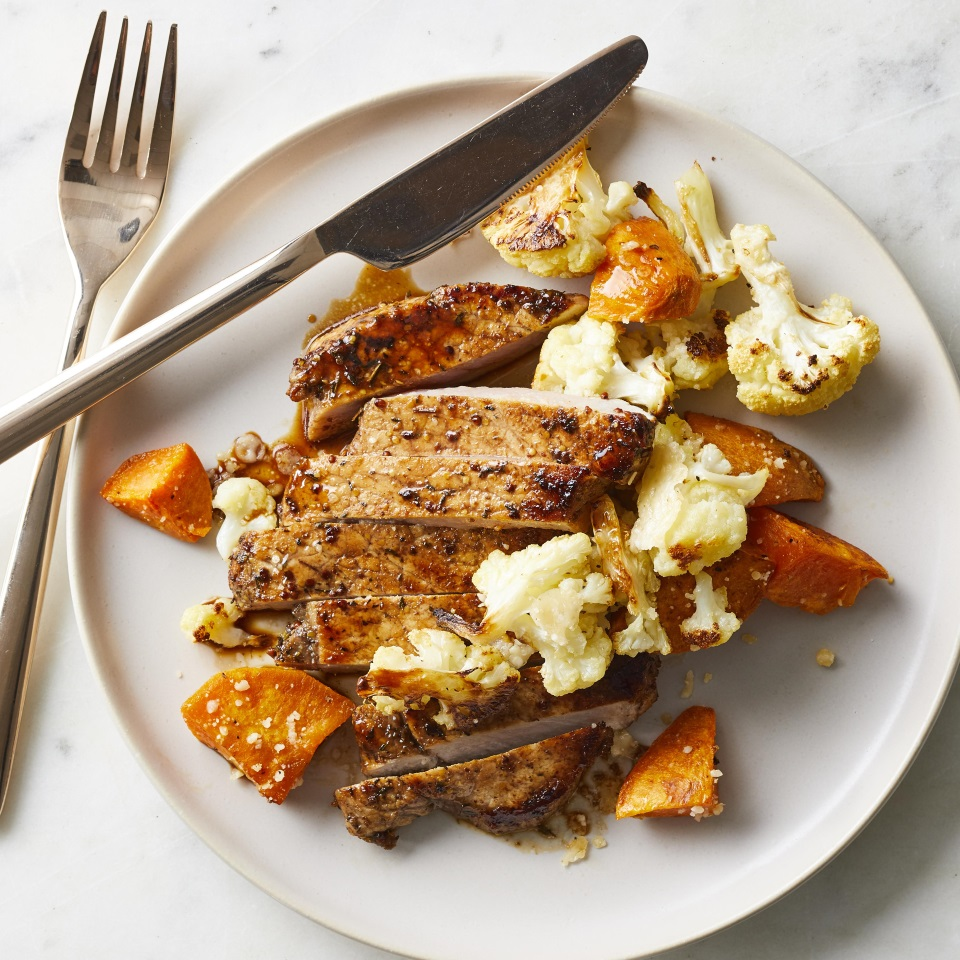 The combination of sweet maple syrup and tangy mustard makes a flavorful marinade for quick-cooking pork loin chops in this healthy dinner recipe. Serve with roasted sweet potatoes and cauliflower for an easy, tasty meal that's ready in under a half an hour (if you marinate the pork ahead of time).
