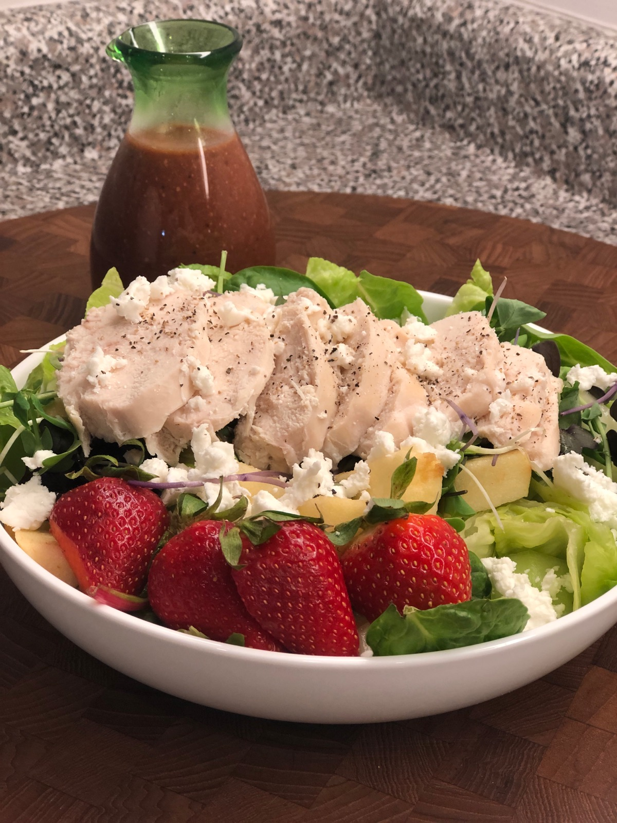 "A simple, satisfying salad with a sweet and tangy dressing. ""You'll love the roasted strawberries!"" says Diana71."