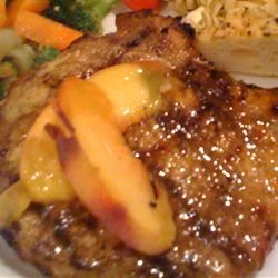 Pork Chops with a Riesling Peach Sauce thedailygourmet