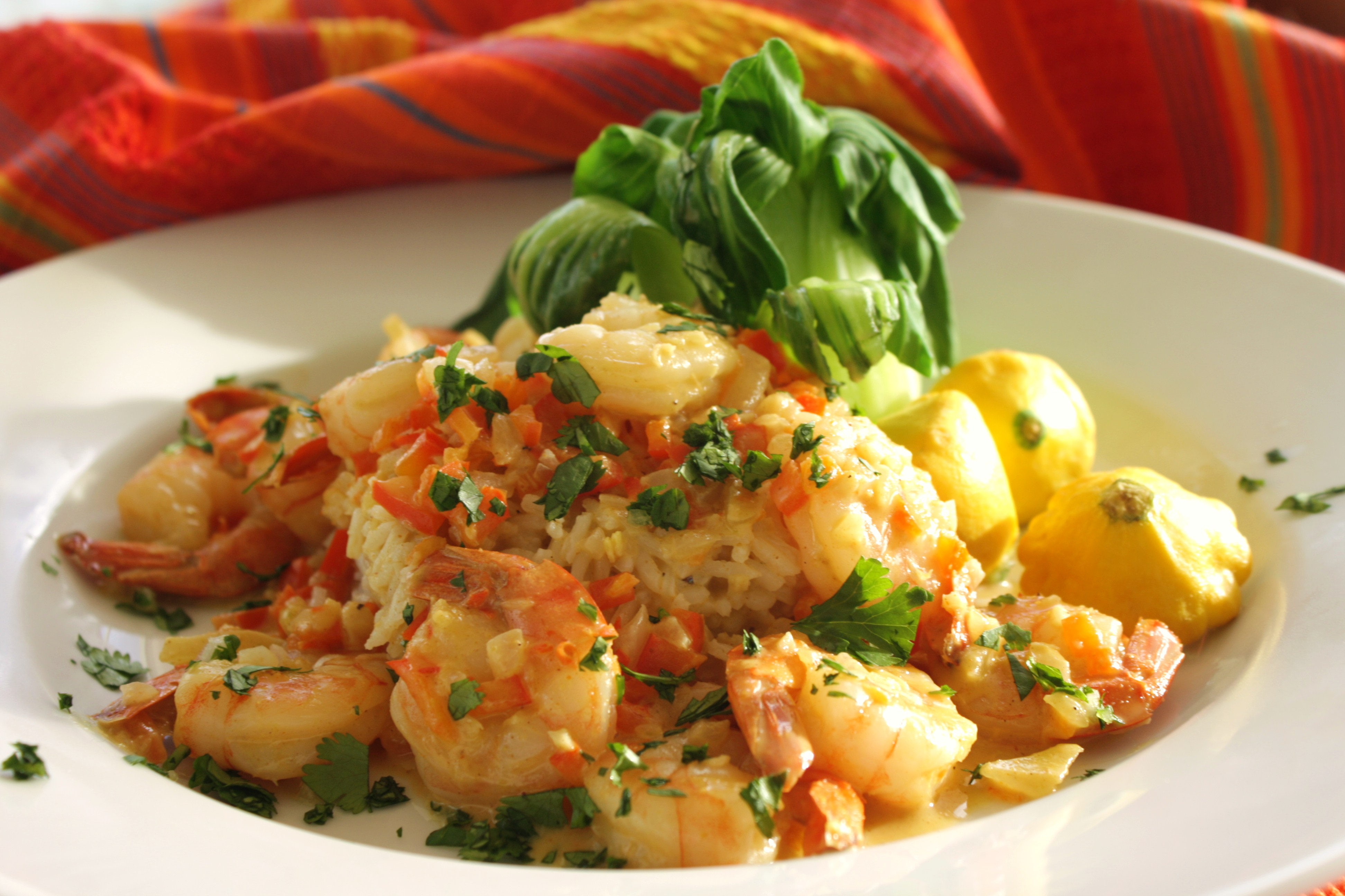 Using light coconut milk keeps this shrimp curry dish under 200 calories per serving (191, to be exact), leaving plenty of room on your plate for a 180-calorie cup of cooked jasmine rice.