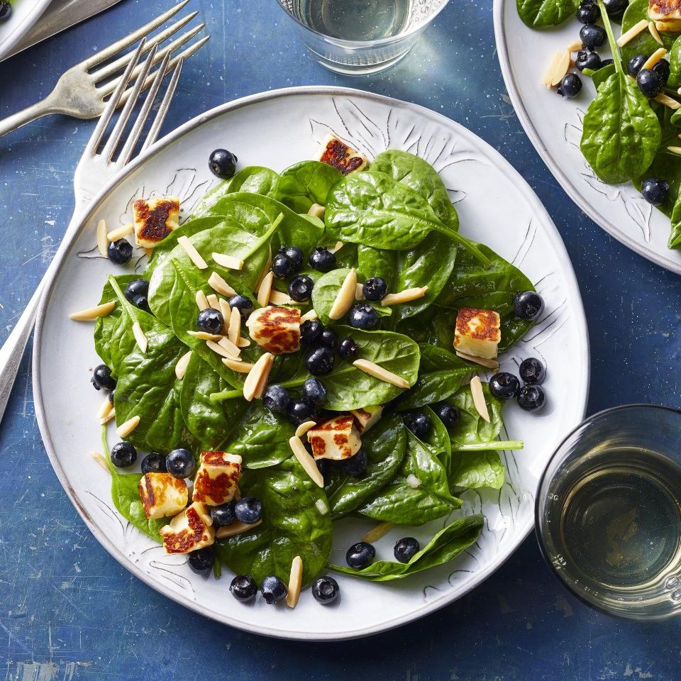 The combination of sweet berries, crunchy almonds and salty cheese in this spinach salad really can't be beaten. Pan-fried bites of the Greek cheese halloumi are a delicious stand-in for croutons. A simple shallot vinaigrette is made right in the same bowl as the salad, so this stunning summer salad is quick and easy to prep too.