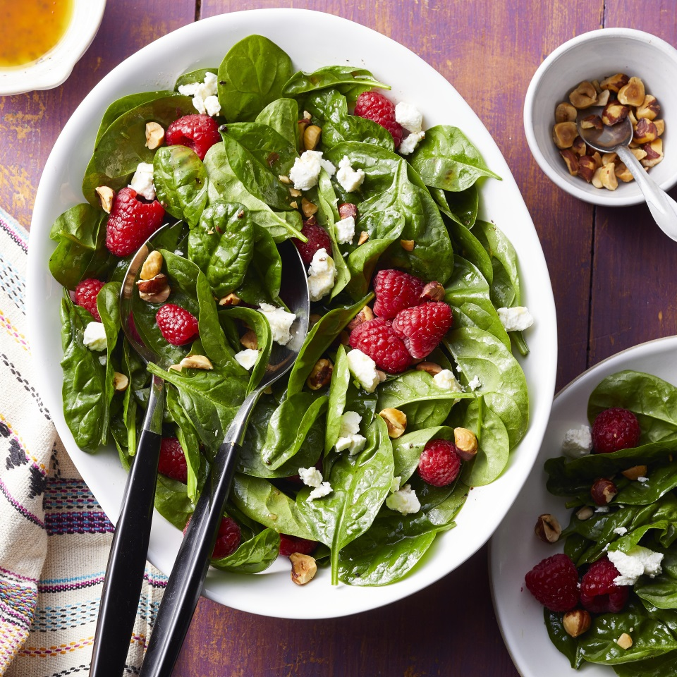 This pretty spinach salad couldn't be easier to make: just whisk together a simple vinaigrette in a serving bowl, then toss it with spinach, goat cheese and hazelnuts. Feel free to swap in your favorite nut for the hazelnuts--this simple salad would also be lovely with pecans, walnuts or almonds. The key is the combo of sweet fruit, tangy vinegar, creamy and salty cheese and crunchy nuts. Serve with grilled chicken or your favorite protein for a healthy dinner that comes together in a snap. Source: Eatingwell.com, June 2019