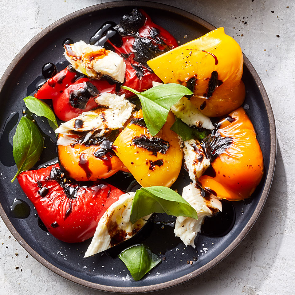 Sweet peppers like red, orange and yellow bells stand in for tomatoes in this caprese-style salad and pair deliciously with the fresh mozzarella and acidic balsamic drizzle. Try green bell peppers if you prefer less sweetness. This easy, healthy recipe takes just 20 minutes to make. Source: EatingWell Magazine, July/August 2019