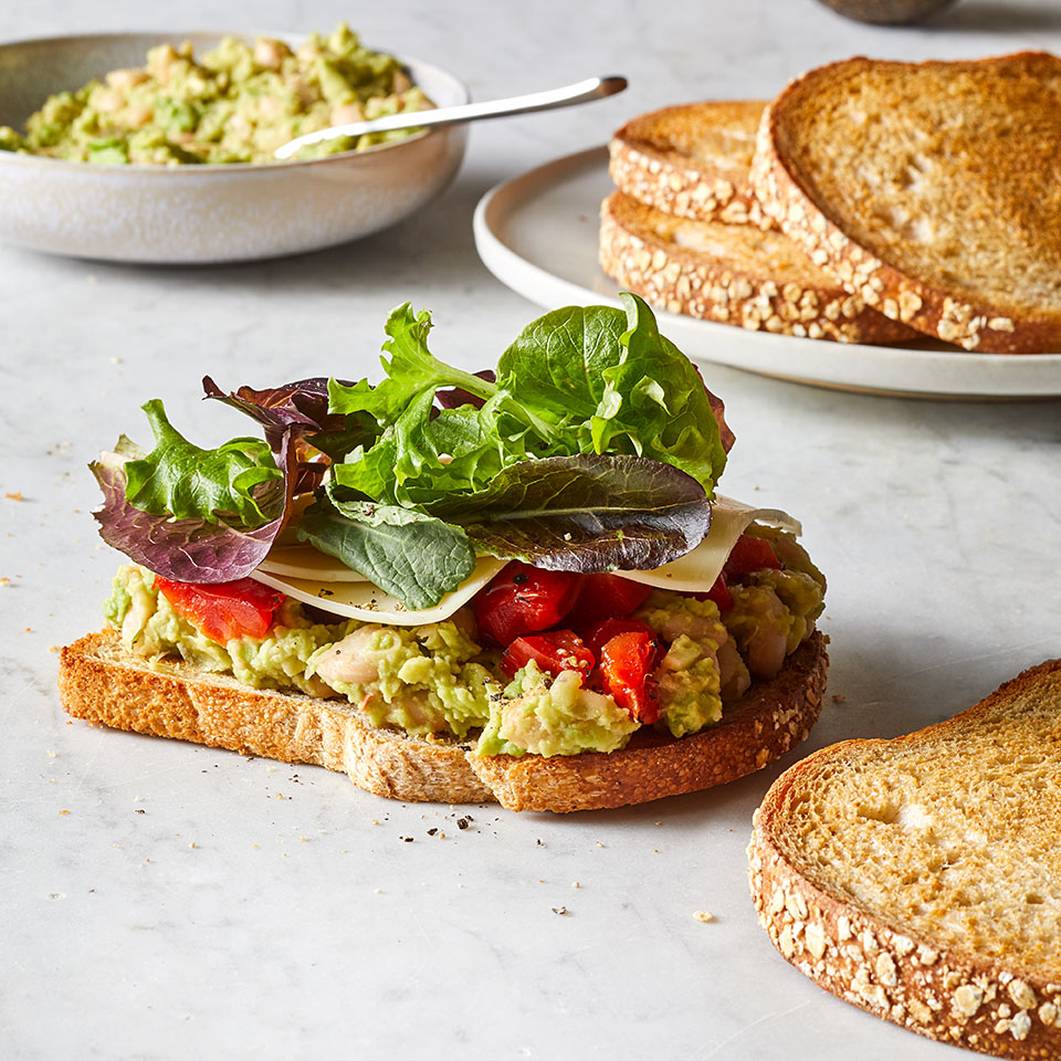 White beans mash seamlessly into a creamy protein-packed spread for a satisfying healthy sandwich that makes for an easy lunch or dinner. Mix it up by trying it with canned chickpeas or black beans. This vegetarian sandwich recipe is also a fiber superstar: avocado, beans, greens and whole-wheat bread team up to give it 15 grams of fiber, more than half of what most women should aim for in a day. Source: EatingWell Magazine, July/August 2019