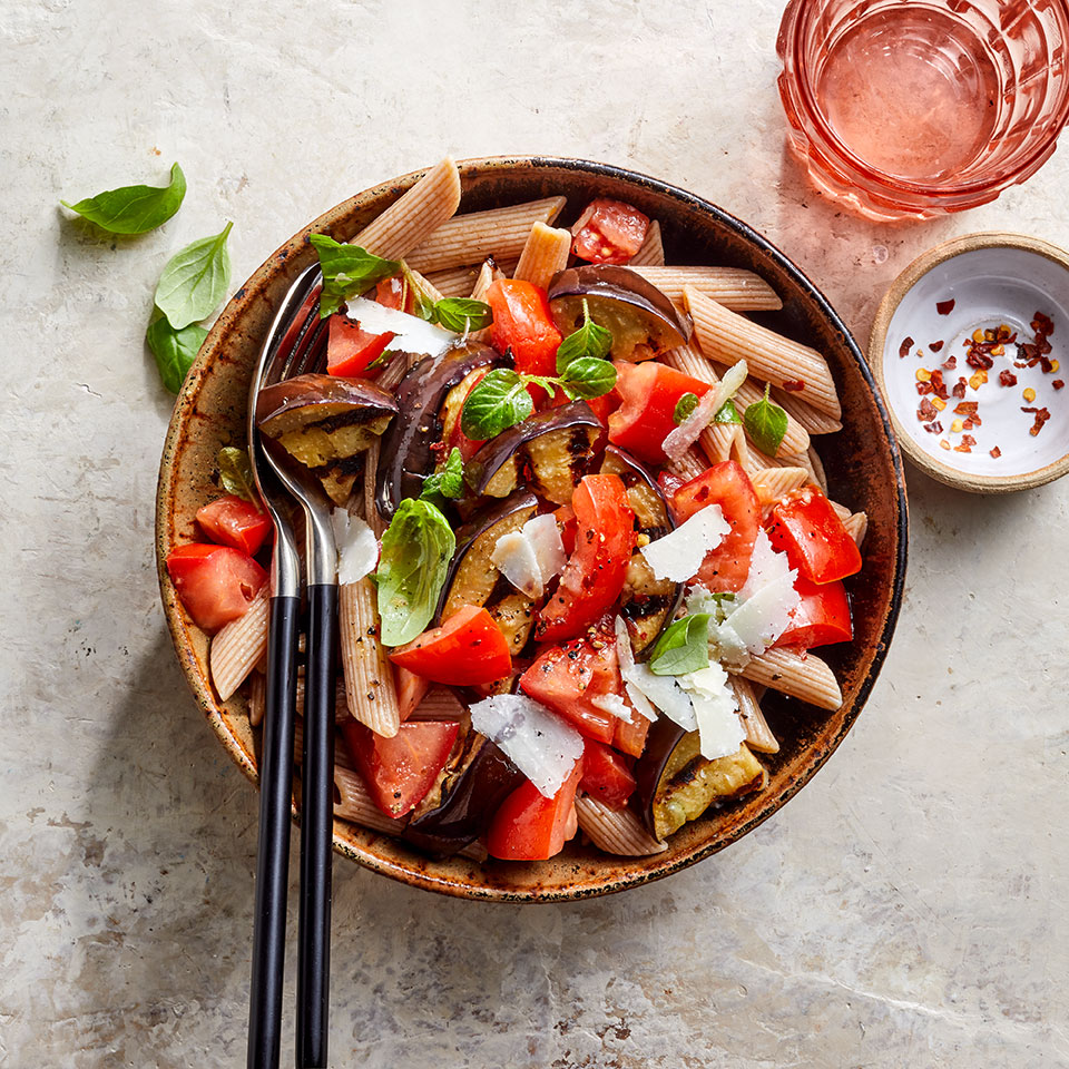 The combination of slightly smoky grilled eggplant and sweet tomatoes is delightful. The eggplant-tomato mixture served over whole-wheat pasta with fresh basil and a bit of salty cheese makes an easy, healthy weeknight dinner. Source: EatingWell Magazine, July/August 2019