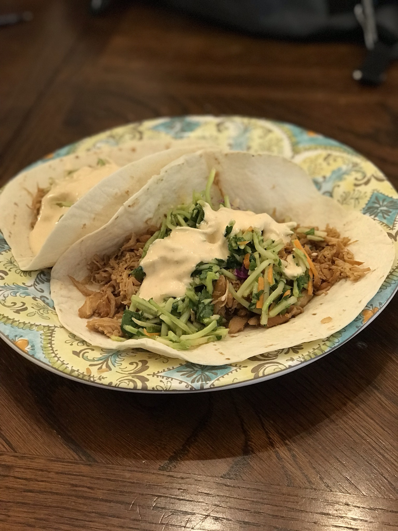 """A slow cooker allows the chicken to get so tender, it just shreds apart while soaking up the delicious marinade,"" says A K. ""These are a perfect combination of sweet, tangy, and spicy in a tacolicious bite! I use a microplane rasp grater for the ginger and lime. Makes 4 soft taco-sized portions or 8 fajita-sized portions! Enjoy!"""