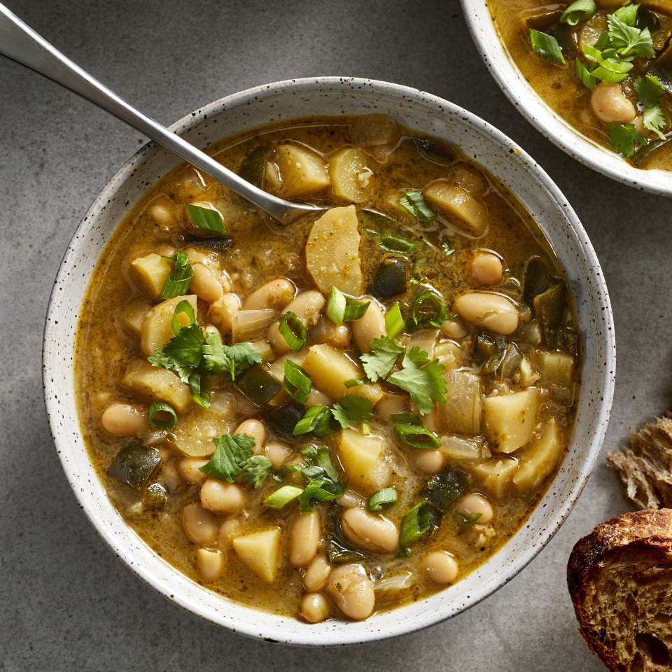 Parsnips lend a wonderful sweet and nutty flavor to this healthy white bean chili. Using an Instant Pot (or any other pressure cooker) means this hearty chili can be ready in under an hour, but it still tastes like it's simmered away for hours. Pureeing some of the chili gives the stew a nice creaminess, but feel free to skip that step to save time. Garnish the chili with cheese and sour cream for a richer meal, or serve it as-is to keep it vegan.