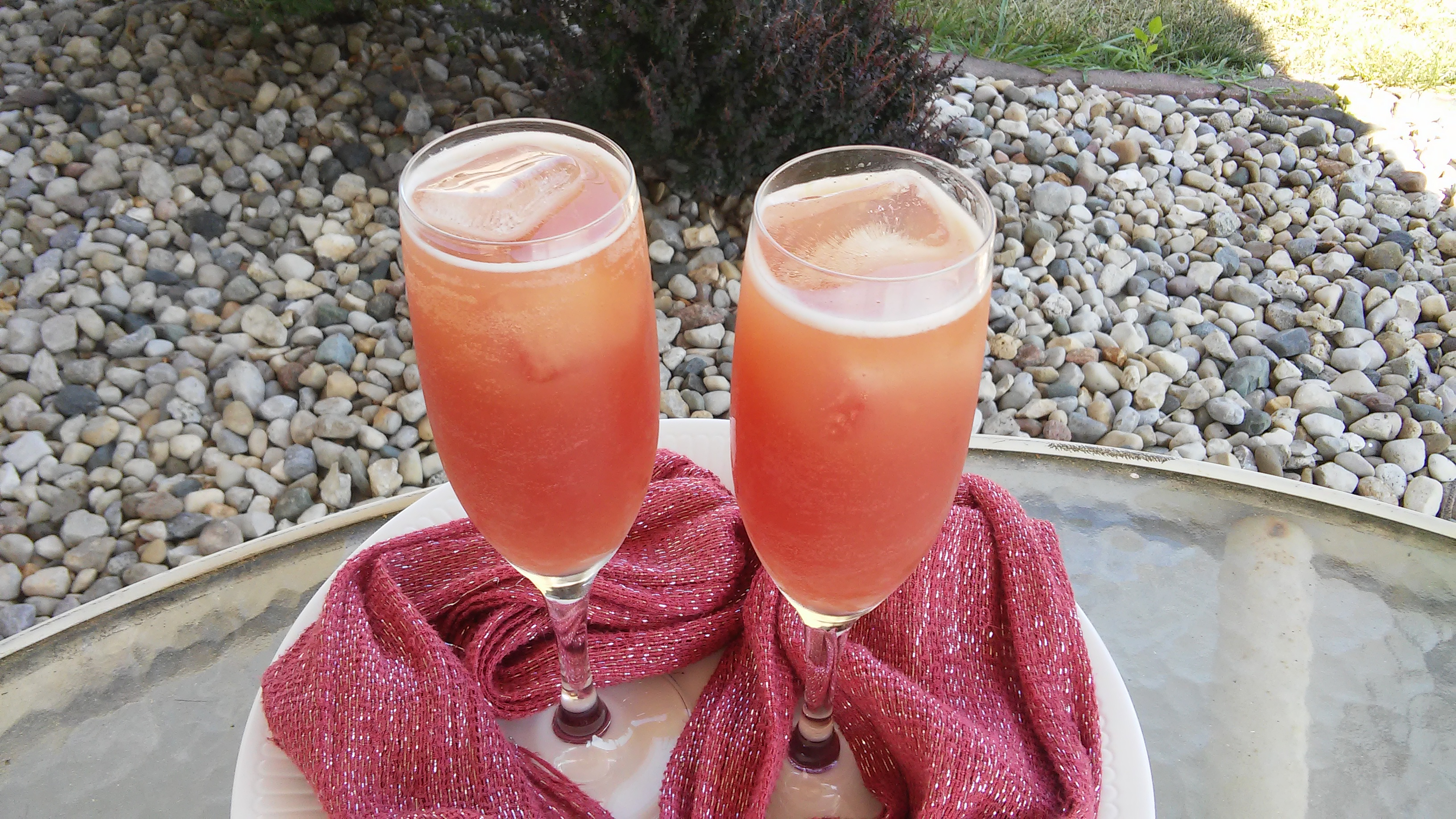 A terrific Christmas or New Year's Eve party mocktail, this fizzy, fun fake Champagne cocktail stars ginger ale and cranberry juice along with OJ concentrate and pineapple juice.