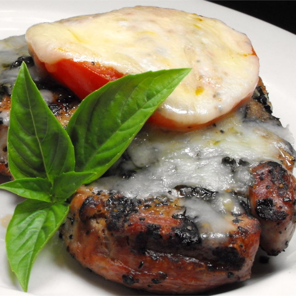 """Chops topped with sliced tomato, basil, oregano, garlic, and mozzarella cheese. Godzilla rates it 5 stars: """"It's 'Amazing' that a recipe so simple is so fabulous! My entire family loves these chops. The fresh tomato slice on top with the herbs and cheese makes these chops so scrumptous.""""                           Related:"""