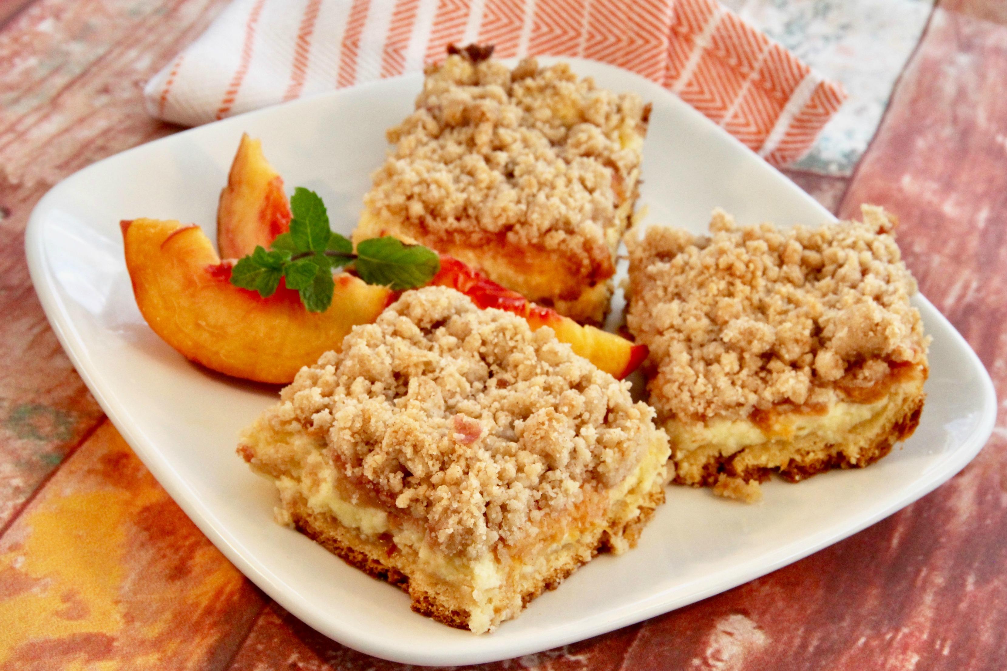 Peach Cobbler Cheesecake Bars lutzflcat