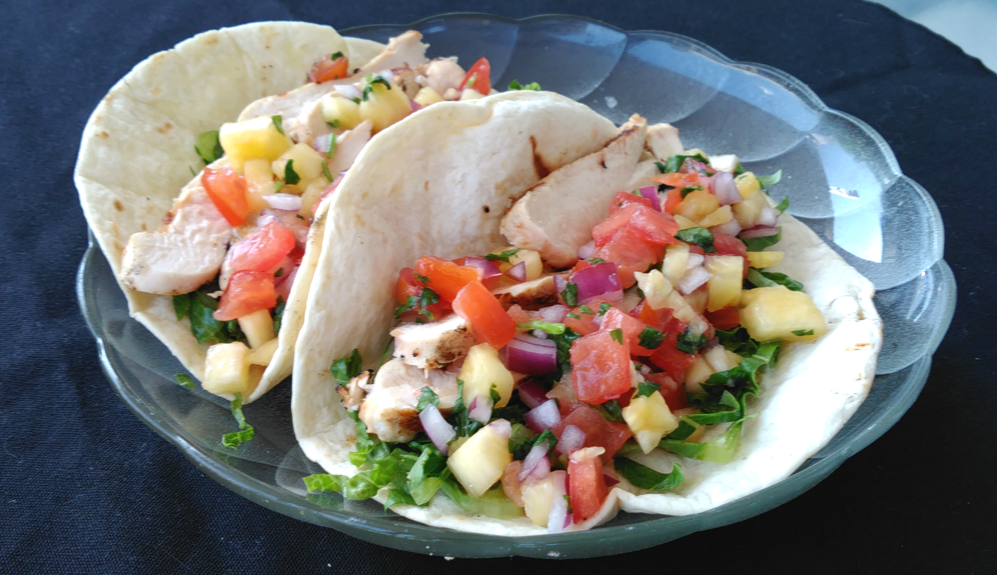 """These chicken tacos with homemade pineapple salsa are quickly assembled once you've marinated the chicken,"" says Bren. ""The actual grill time is only about 6 minutes."""