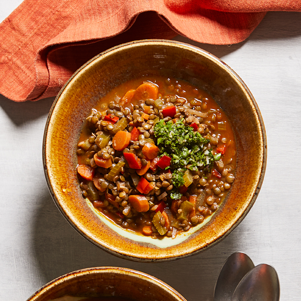 This healthy vegetarian recipe is hearty and satisfying. Don't skip the parsley relish (salsa verde)--it's easy to make and lends a tangy accent that balances the flavors of the lentil stew. We prefer French green lentils for this stew, as they don't fall apart while cooking; however, regular brown lentils (found in most supermarkets) will also work.