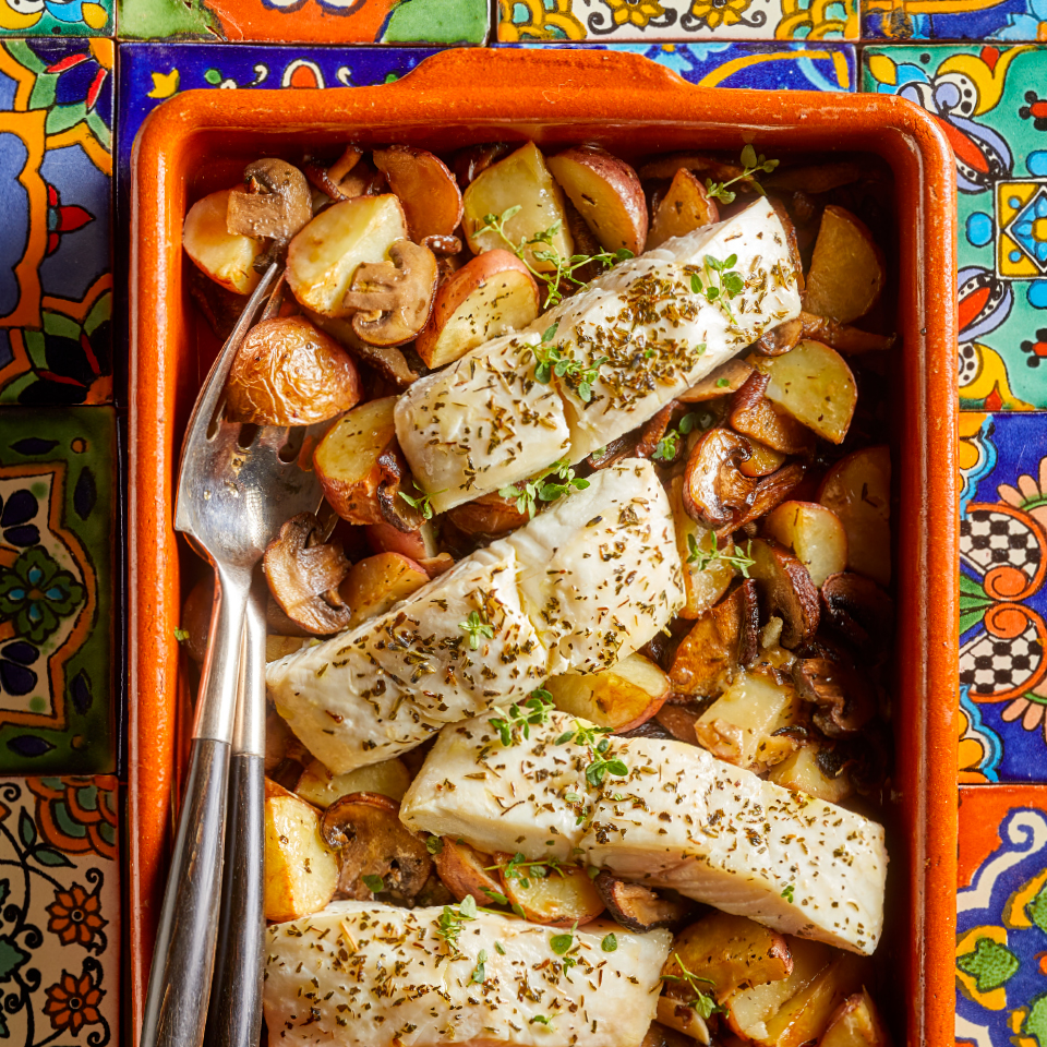 This easy healthy meal--which requires just 15 minutes of active time--is typical of southern France. You can use halibut, grouper or cod for this simple Mediterranean baked fish recipe, so just choose what looks best at your market. Look for herbes de Provence, an aromatic spice blend, at most grocery stores.