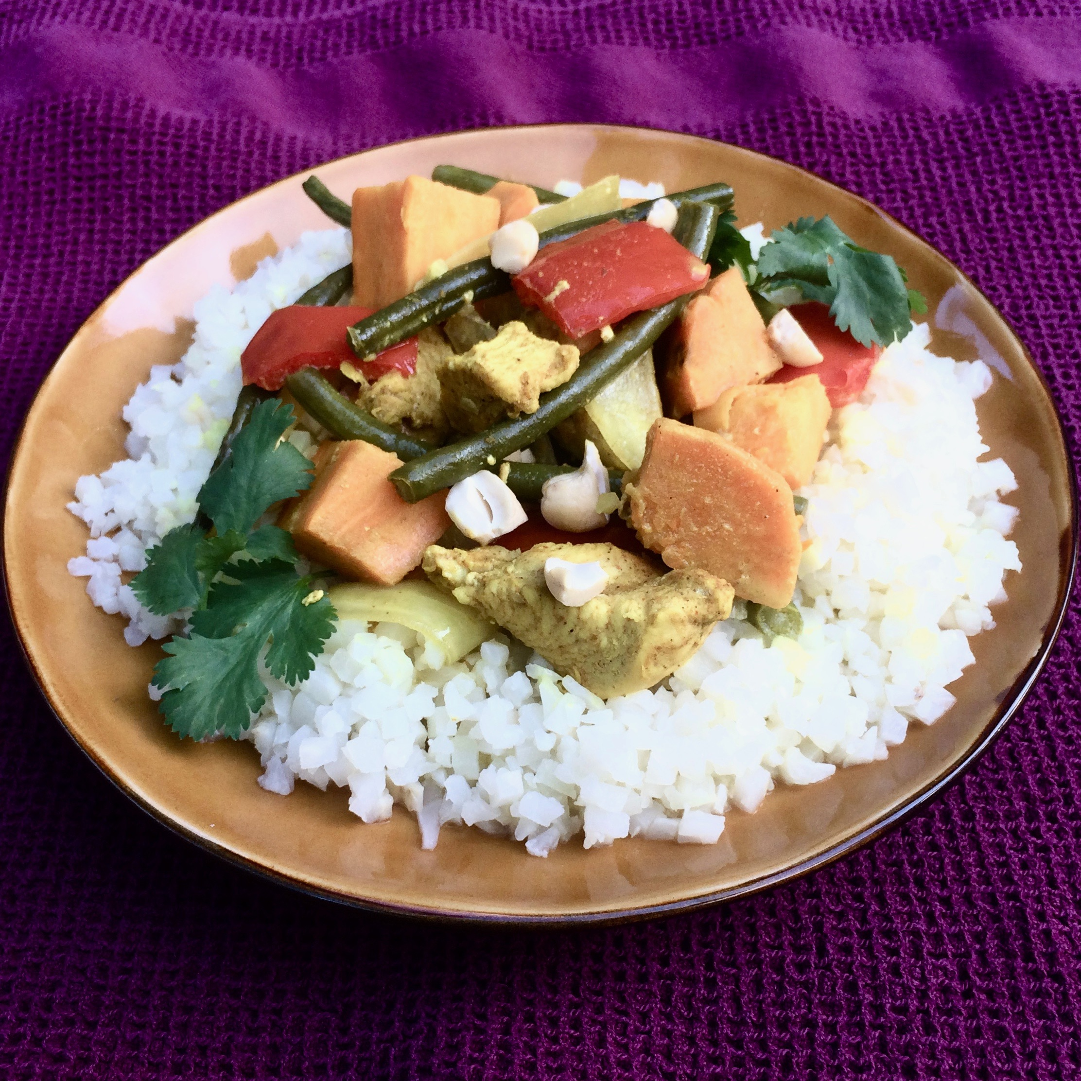 """Try this easy coconut curry in your slow cooker with sweet potato, green beans, bell pepper, and onion,"" says Bibi. ""Serve over either riced cauliflower or jasmine rice, as you prefer."""