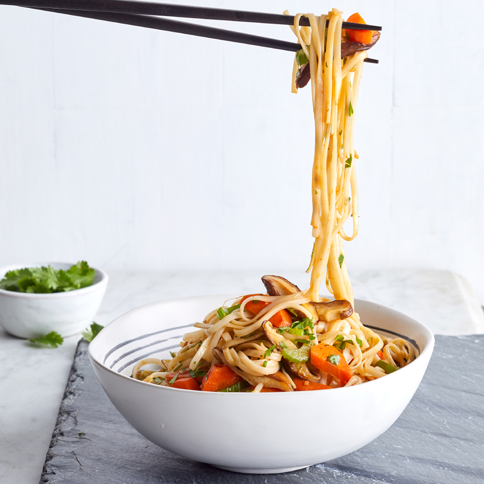 A hit of Sriracha gives a sweet and spicy edge to this healthy vegetarian recipe. Traditional lo mein is made with fresh lo mein noodles, which can be found in Asian markets. You can also use fresh or dried linguine noodles—fresh linguine is in the refrigerated section of some grocery stores. This easy dinner comes together in just 30 minutes, so it's perfect for weeknights.