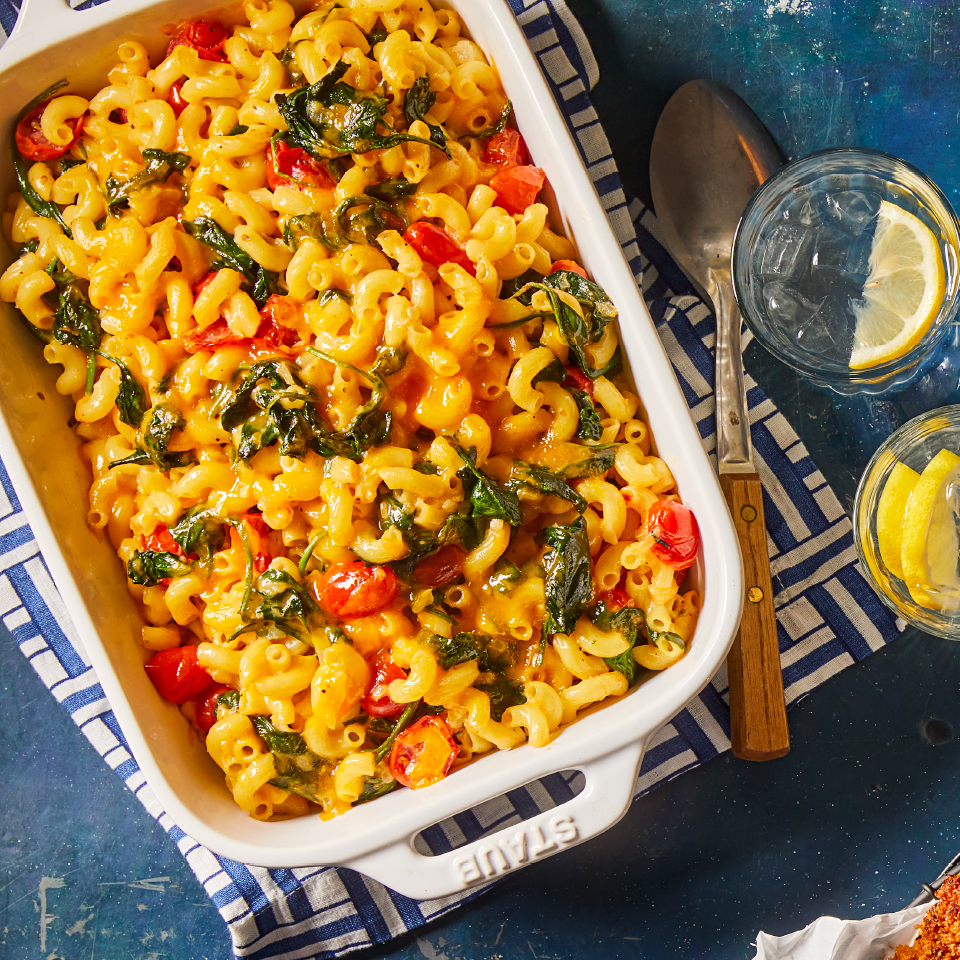 An old-school classic gets a boost of nutrition and flavor from garlicky spinach and tomatoes in this healthy mac and cheese recipe. Source: Diabetic Living Magazine, Fall 2019