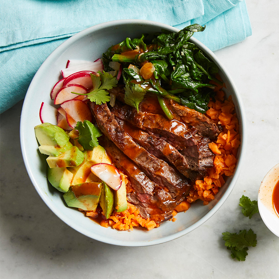 "You won't miss the regular rice in these hearty bowls, which feature sweet potato ""rice"" that's quickly made in your food processor. The simple swap means a welcome burst of color and flavor, plus way more vitamin A, vitamin C and potassium. This quick and easy recipe is sure to become a weeknight favorite. It takes about half an hour to prep, but you can make it even faster by swapping in store-bought sweet potato rice. Source: Diabetic Living Magazine, Fall 2019"