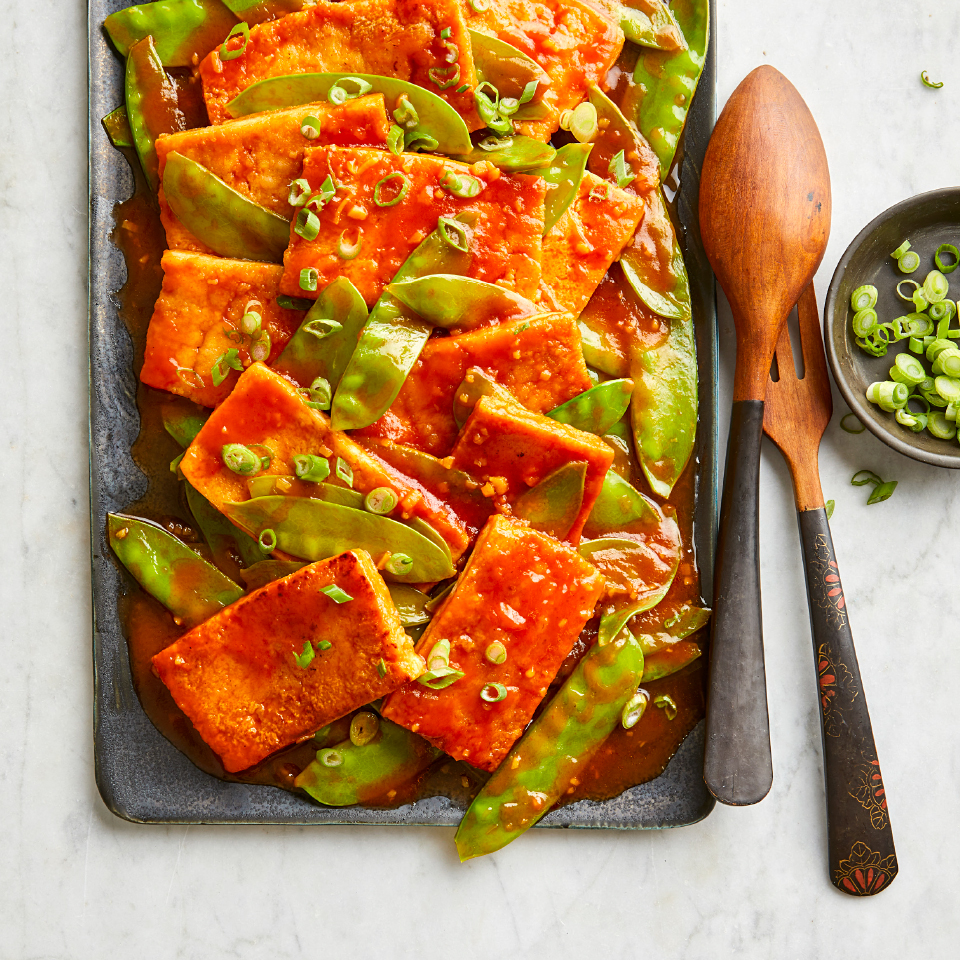 This healthy sweet and sour tofu stir-fry is easy to whip together on weeknights. Just be sure to plan ahead so that you can freeze the tofu in advance. It gives the tofu a meatier texture and helps it absorb the sauce.