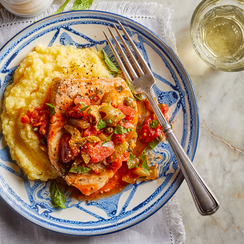 Swordfish with Olives, Capers & Tomatoes over Polenta Amy Riolo