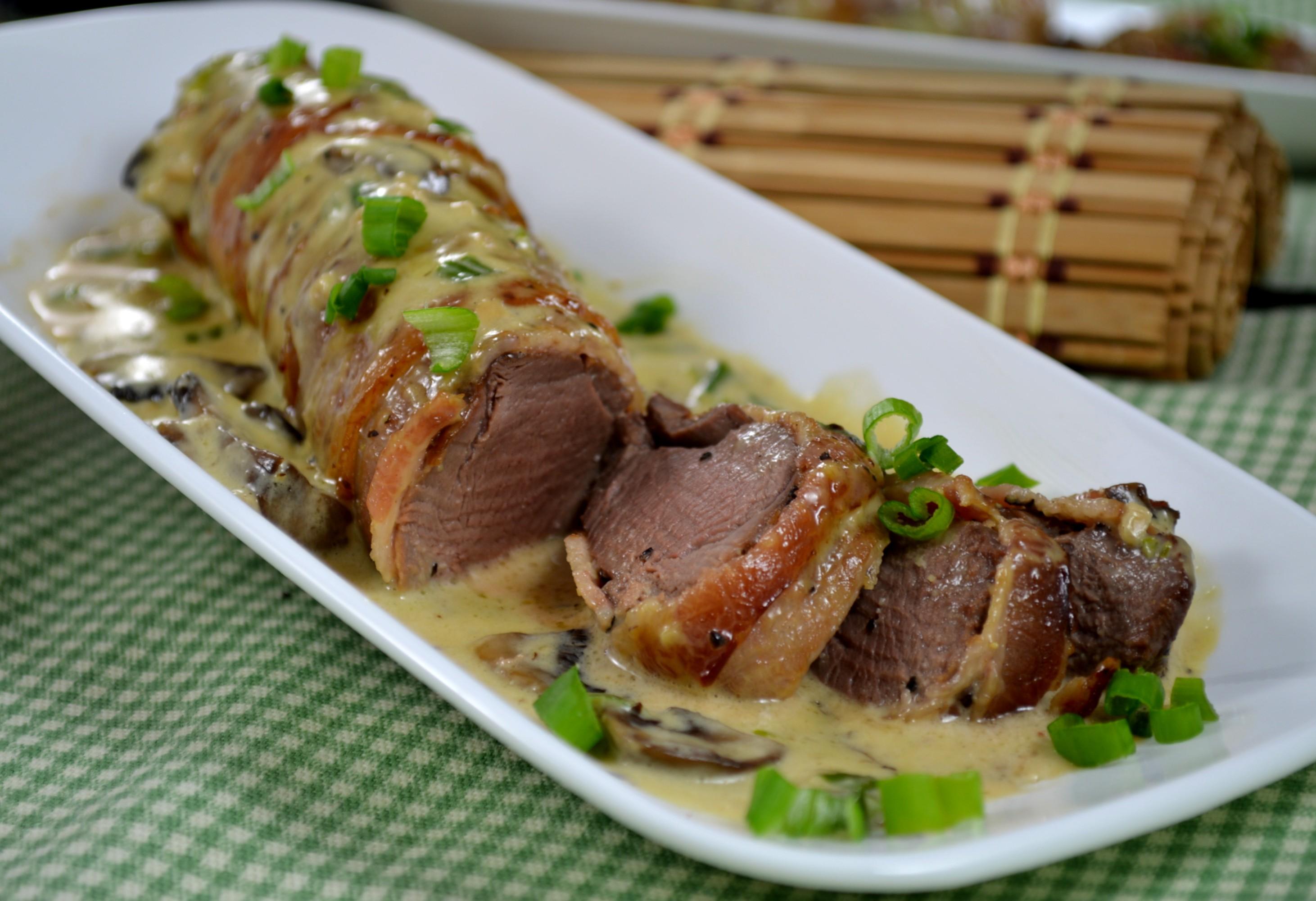 Bacon-Wrapped Venison Tenderloin with Garlic Cream Sauce
