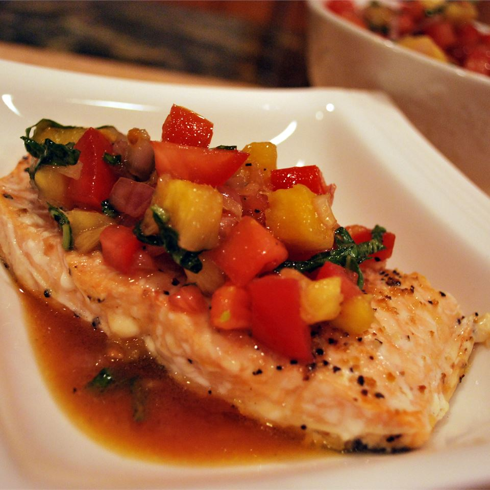 """A very colorful, refreshing summer salmon dish that is full of flavor and a great way to use your garden tomatoes,"" says Valerie Brunmeier."