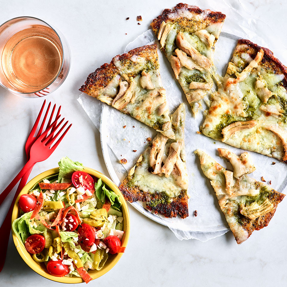 While the antipasto salad has a distinctly retro vibe, the cauliflower-crust pizza is 100% au courant for pizza night. If you've never tried cauliflower crust, get ready to be pleasantly surprised! This recipe calls for store-bought cauliflower pizza crust, so this easy dinner comes together in just 30 minutes. This recipe makes extra roasted chicken thighs. Use the leftovers in salads and meal-prep lunches or to make Chicken & Quinoa Buddha Bowls (see Associated Recipes). Source: EatingWell Magazine, September 2019