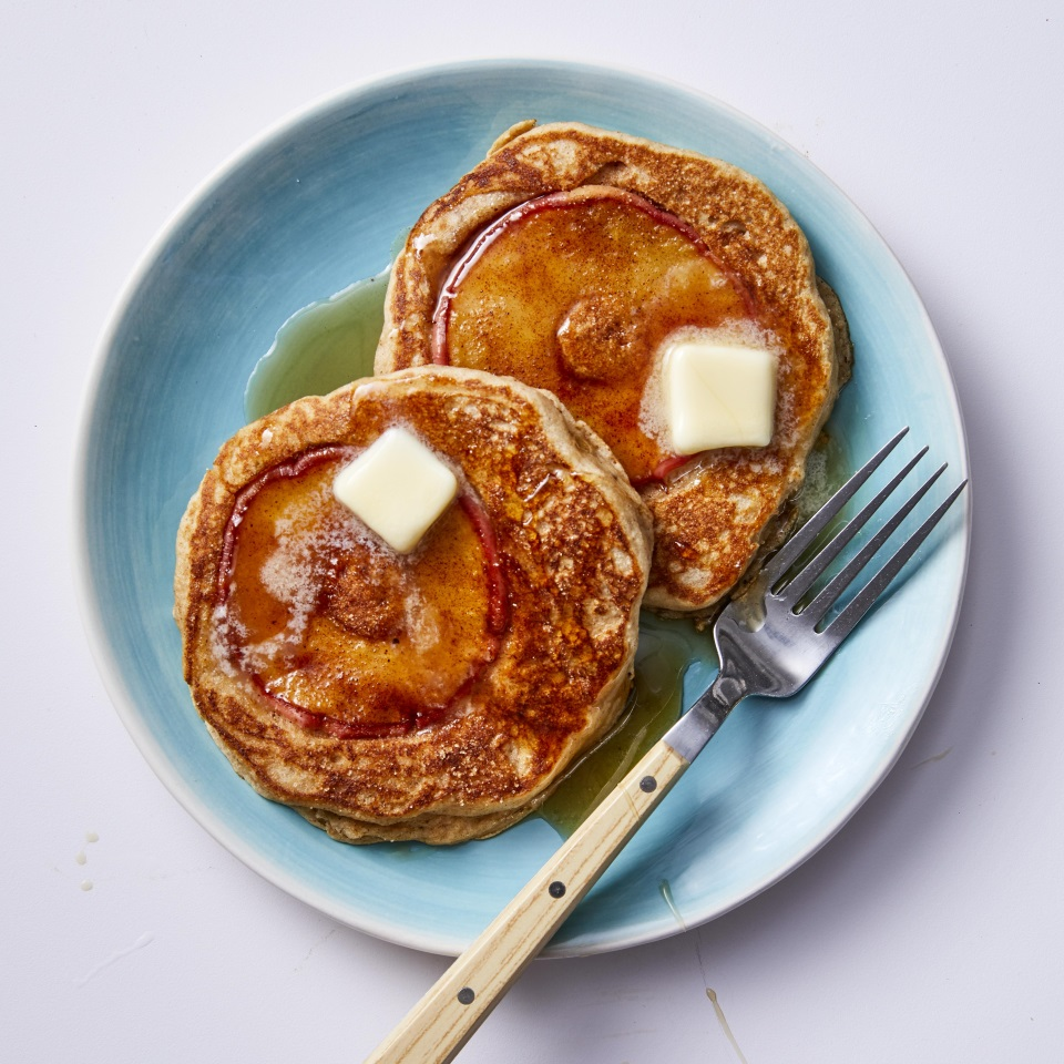 These healthy apple pancakes puff to perfection thanks to the right combination of ingredients, including a mixture of double-acting baking powder and baking soda (using both ensures the batter will spread out evenly and rise well). Ricotta cheese makes pancakes moister than using milk alone, and it packs nearly four times more protein than whole milk. Walnut oil is full of healthy fats and has a rich, nutty flavor, and white whole-wheat flour packs in more fiber than all-purpose flour. A bit of buttermilk adds a nice tang to these flapjacks. All in all, it adds up to a healthy breakfast that's sure to impress. Source: EatingWell Magazine, September 2019