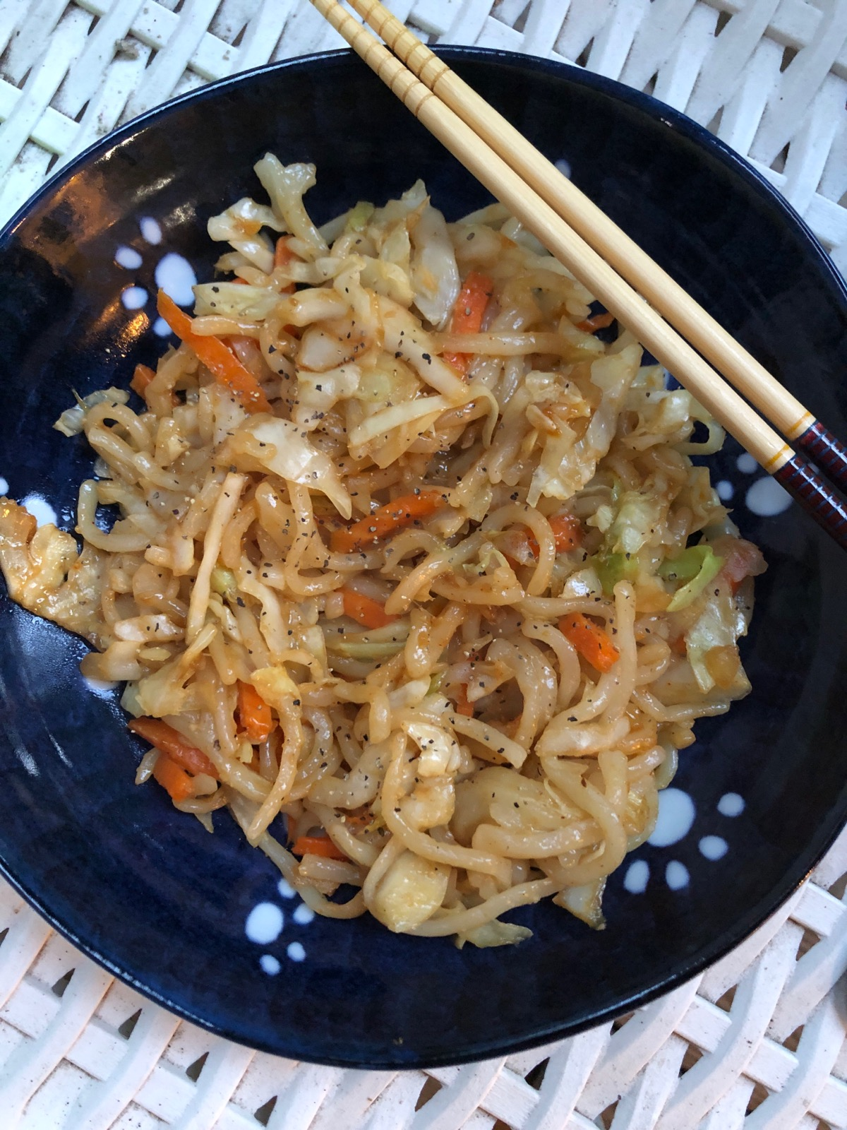 """Shredded cabbage, bell peppers, carrots, garlic, and onions combine with strips of boneless, skinless chicken breast meat and udon noodles in this delicious stir fry that's ready in 30 minutes! """"Similar to yakisoba but made with thick, white udon noodles and tossed with a much simpler sauce,"""" says Diana71. """"Often used in soups, udon noodles are also delicious fried--the texture is just awesome because they are chewy. Try to find frozen or fresh udon noodles. Dried udon noodles will work, too, but you'll lose some of the signature texture."""""""