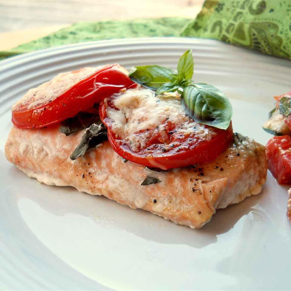 This tomato basil salmon is as simple as it gets, but looks super posh. Serve on a bed of pasta.