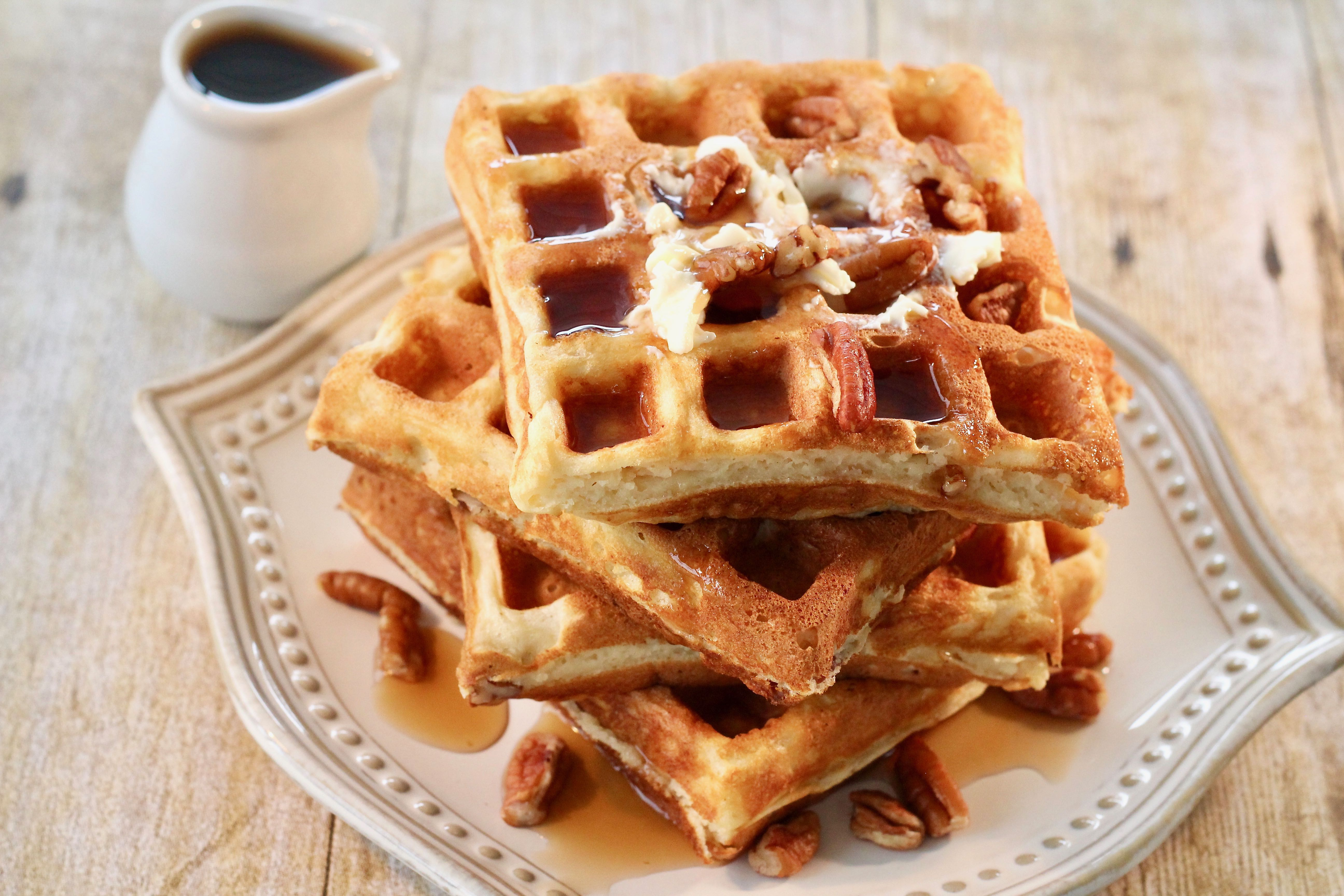 """Crispy on the outside, soft on the inside, with a little crunch from the pecans,"" says lutzflcat. ""Keep waffles warm in the oven as they complete cooking and come off the waffle iron. The ricotta adds tenderness, richness, and great texture to the waffles. Breakfast, brunch, or breakfast-for-dinner never looked better! Serve with butter, maple syrup, and additional pecans, if desired."""