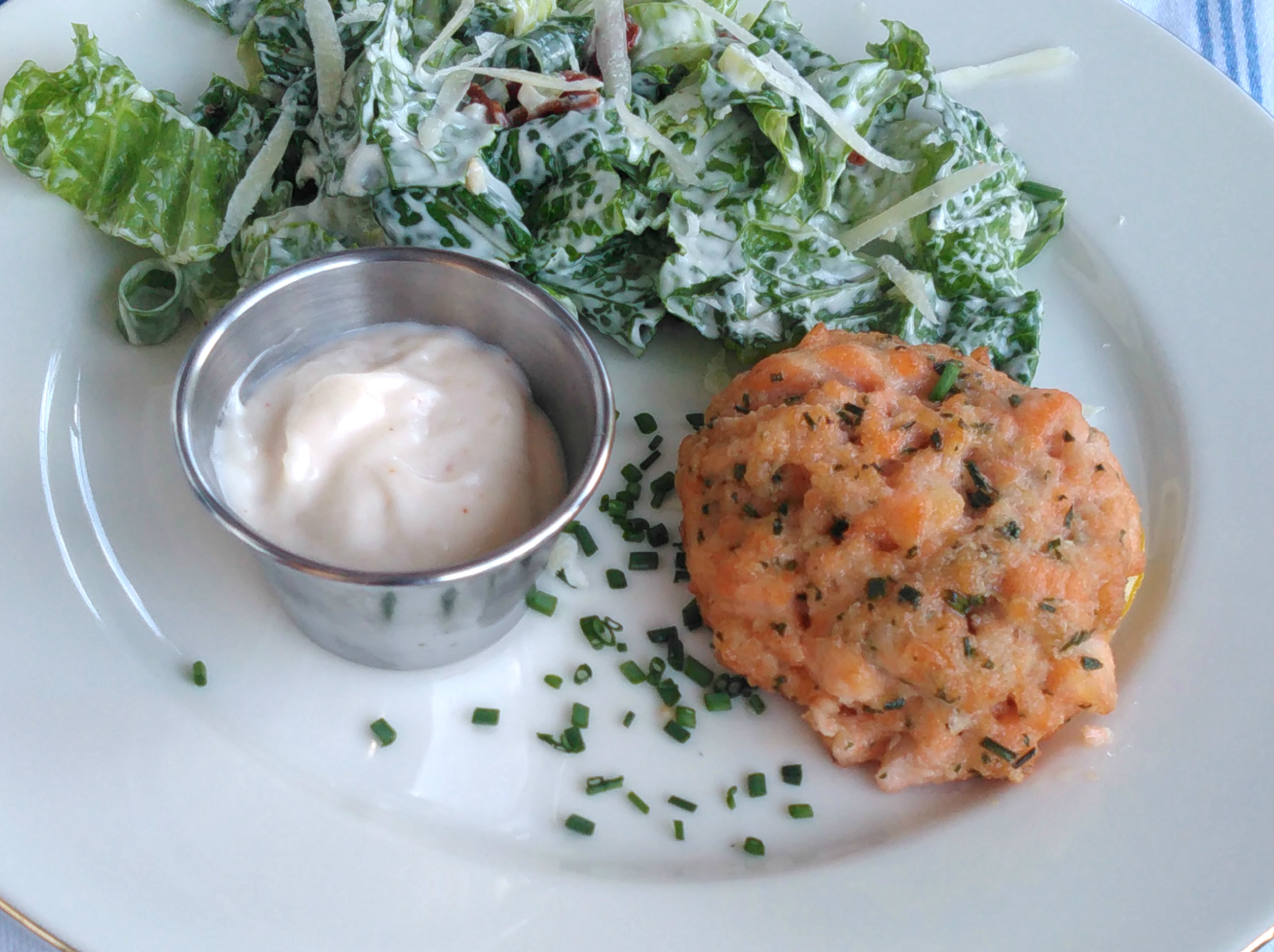 "Air-fried to crispy, golden-brown deliciousness, these minced salmon cakes are ready in less than a half hour. ""Fresh salmon patties are cooked golden in an air fryer and paired with a zesty aioli dipping sauce for an easy dinner,"" says Bren."