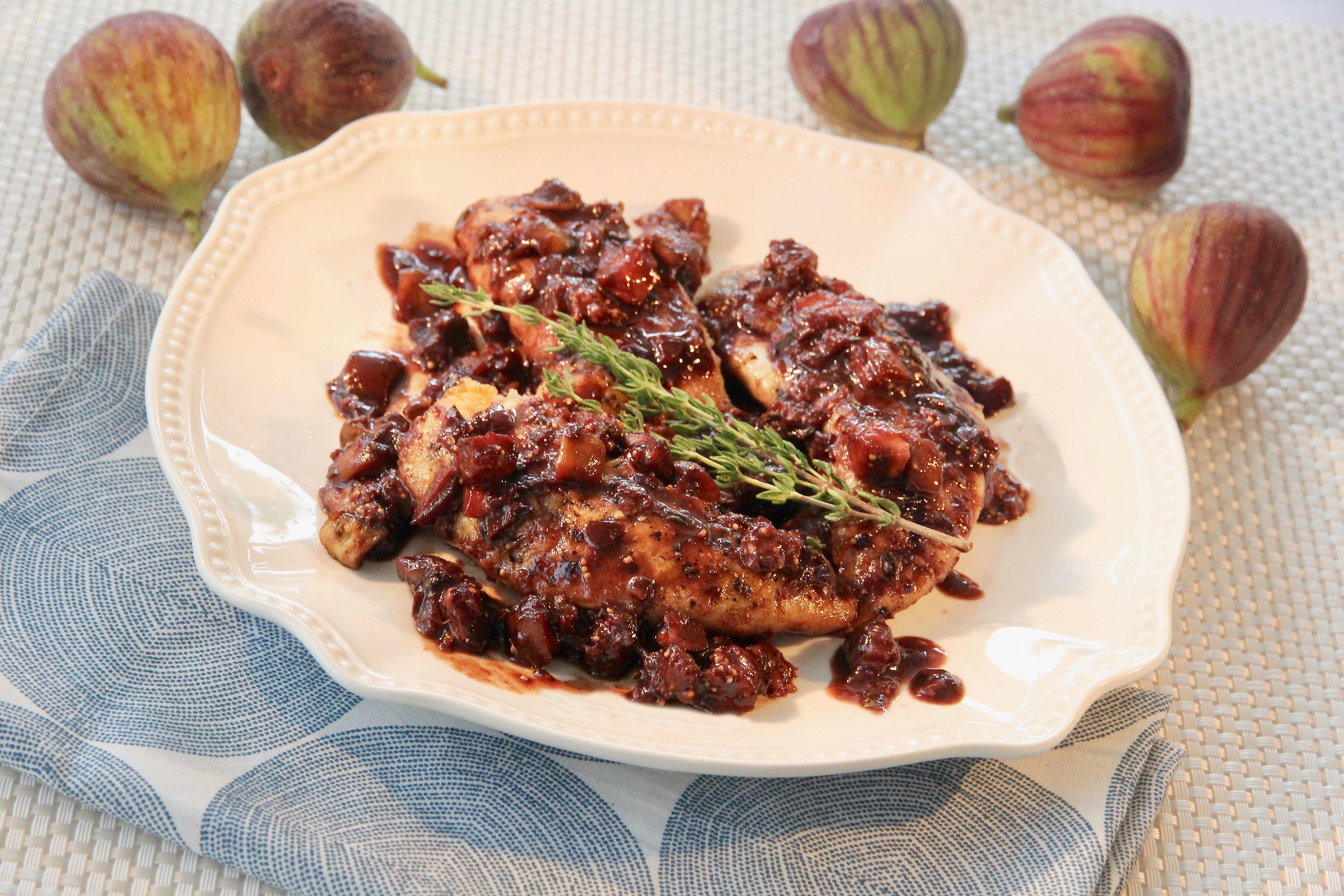 """Boneless, skinless chicken breasts sizzle in the pan with a wine, balsamic vinegar, shallot, and fig sauce, kicked up with a little Dijon and a touch of honey. lutzflcat says, """"The balsamic vinegar is a nice contrast to the sweet figs which add great texture, and the thyme provides just a bit of savoriness to this sweet and rich sauce."""" Dinner's ready in about 35 minutes."""