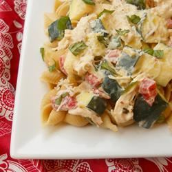 "Here's a quick, delicious summer pasta packed with zucchini and chicken is the perfect topping for ! ""I whipped this up tonight, trying to use some of the zucchini from our garden,"" says njmom. ""I also threw in some leftover chicken and made a complete meal! Quick and easy!"""