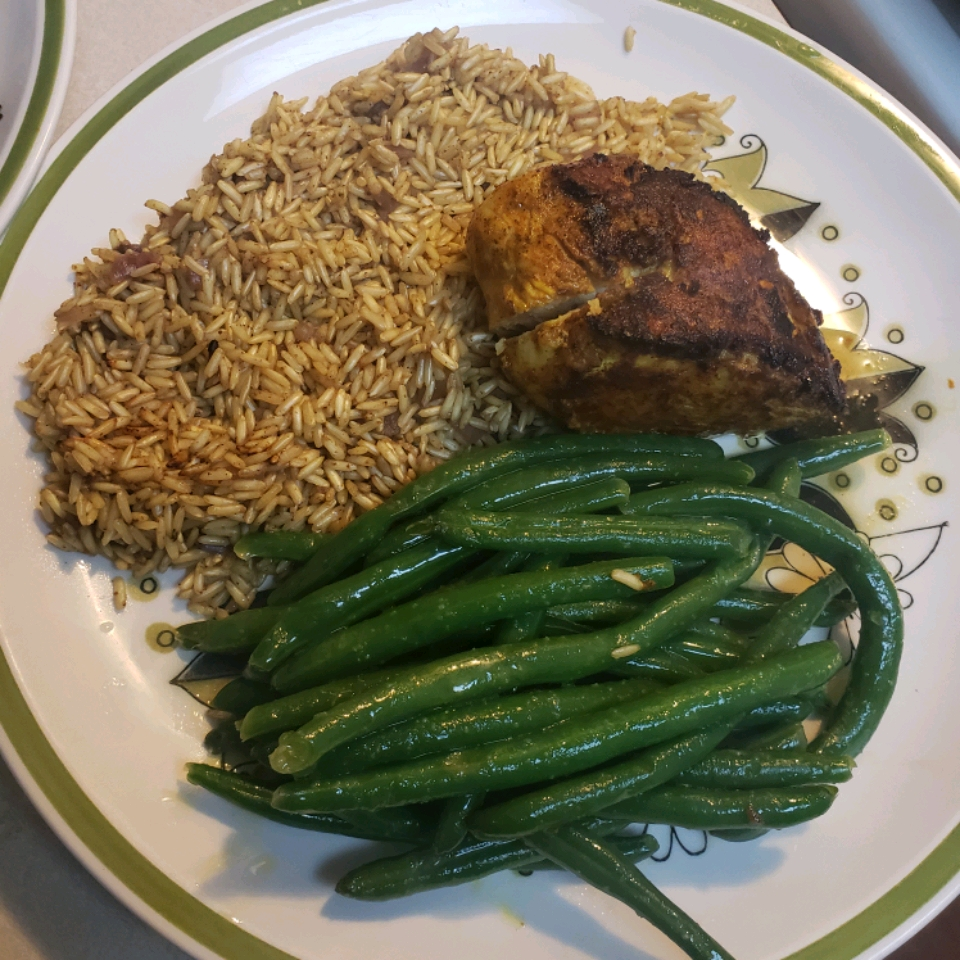 """""""A paste made from a combination of spices and dried peppers is the secret to this spicy grilled chicken recipe,"""" says DAKOTAGIRL. """"No long marinating time is required; the chicken can be prepared in the time it takes to get the coals hot."""""""