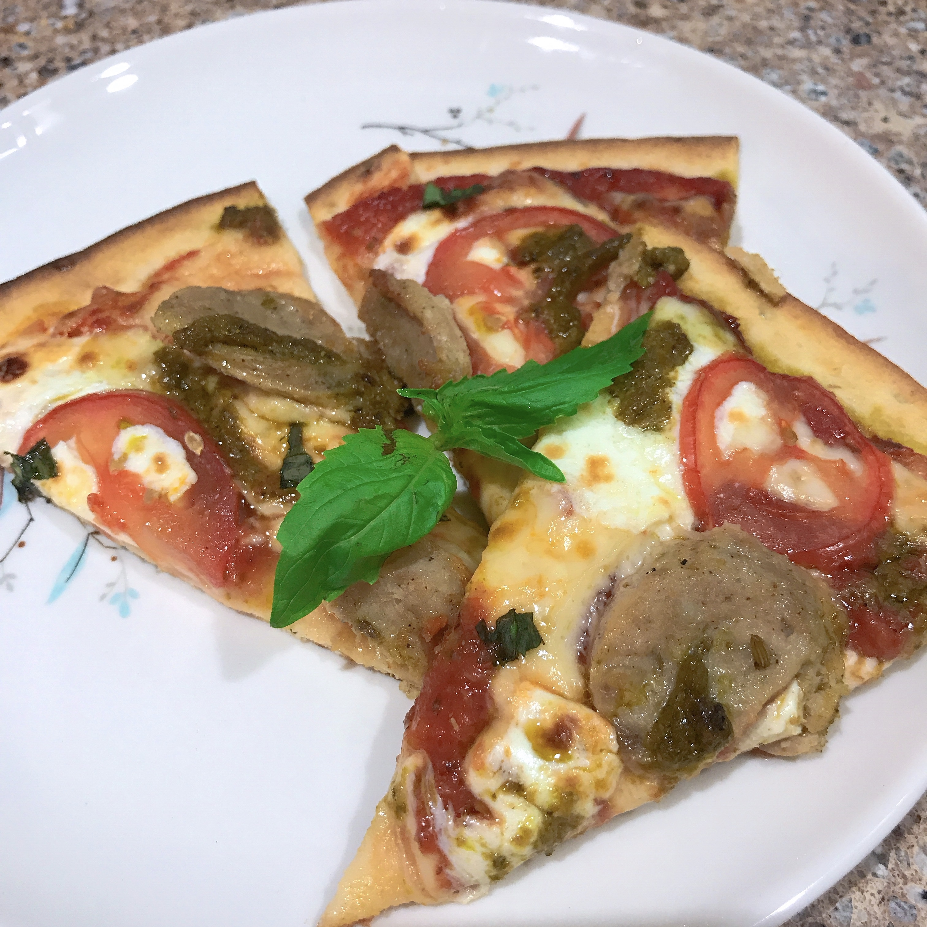 Margherita Pizza with Sausage and Pesto thedailygourmet