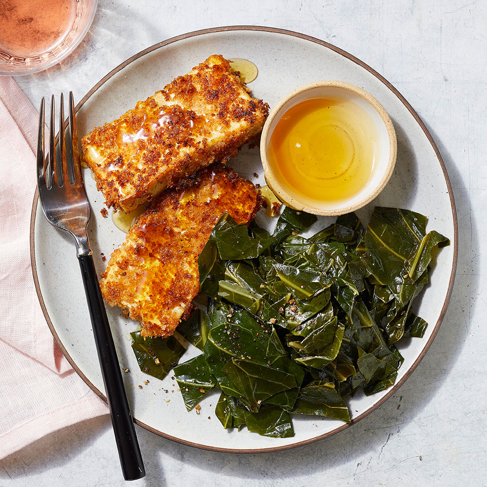 Dipping tofu in buttermilk makes the coating stick for a crispy pan-fried tofu, reminiscent of fried chicken. Spicing up the collards with paprika coats them with smoky flavor while keeping this dish vegetarian. And this quick, easy and healthy dinner comes together in just 25 minutes, so it's great for busy weeknights.