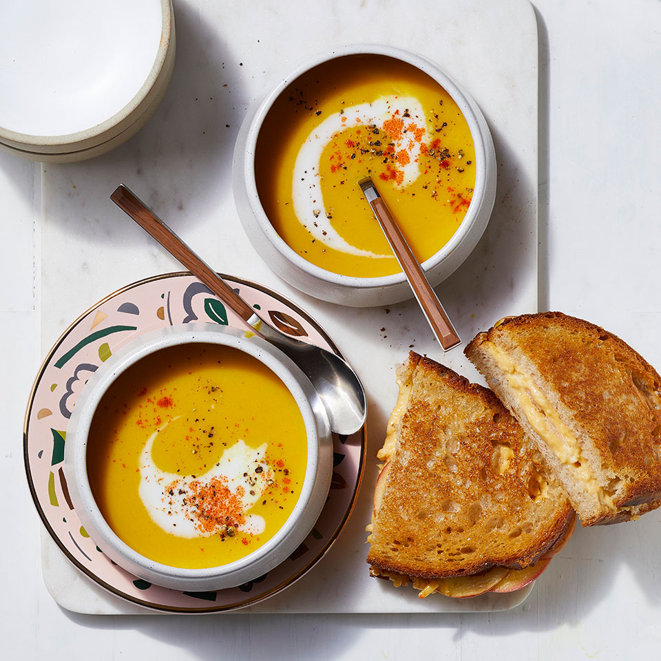Layering apple slices into grilled cheese sandwiches adds a little crunch to a favorite soup dipper. And creamy butternut squash soup with ginger, cumin and turmeric is a nice change of pace from grilled cheese's usual tomato soup partner. Serve the duo for a comforting and easy weeknight dinner for the family.