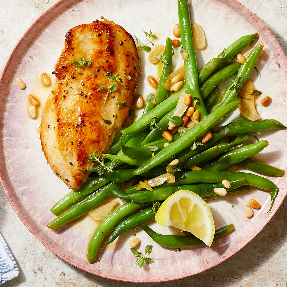 This easy lemon-garlic chicken recipe calls for cutlets, which cook in less than 10 minutes! Can't find them? Make your own from chicken breasts. Place each breast on a cutting board and, with your knife parallel to the board, slice into the skinny side of the chicken breast in a single smooth motion. The side of green beans is cooked right in the same pan as the chicken, so this 20-minute easy, healthy dinner is not just a snap to prepare--the cleanup is a cinch too. Source: EatingWell Magazine, October 2019