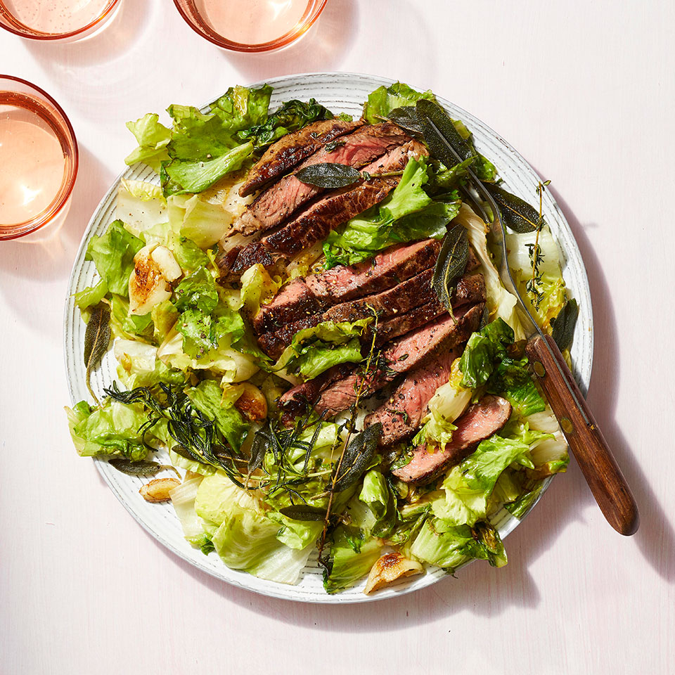 This easy dinner takes just 20 minutes to prepare, meaning that seared steak can be a weeknight meal. Cooking herbs in the pan with the steak releases their aroma, infusing it into the meat while creating a crispy garnish. After the steaks and herbs are pan-seared, the escarole is cooked in the same skillet, so this healthy dinner requires minimal cleanup too.