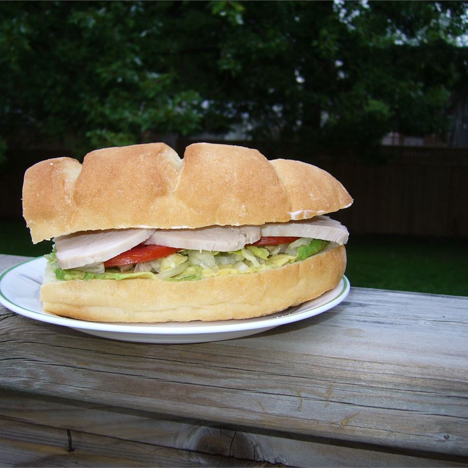 """Torta is a Mexican sandwich served on a white sub-style roll and filled with any number of meats, eggs, and other toppings and condiments. Torta ahogada, meaning """"drowned sandwich,"""" is a Guadalajaran version of the torta, filled with pulled pork smothered in a savory red sauce."""