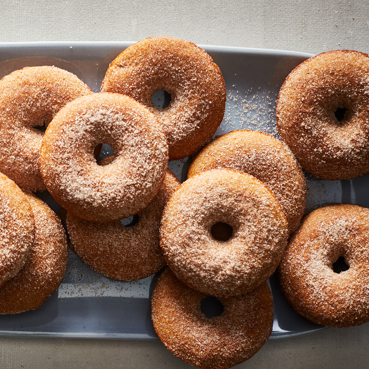 "Fluffy and light with a warm cinnamon flavor, you'll be craving these homemeade donuts (with a hot cup of coffee) all fall! Because apple cider can be harder to find year-round, take advantage of when it's ""in season."" Don't forget to make a few extra batches and freeze the donuts to enjoy when cider isn't available. Source: EatingWell.com, September 2019"