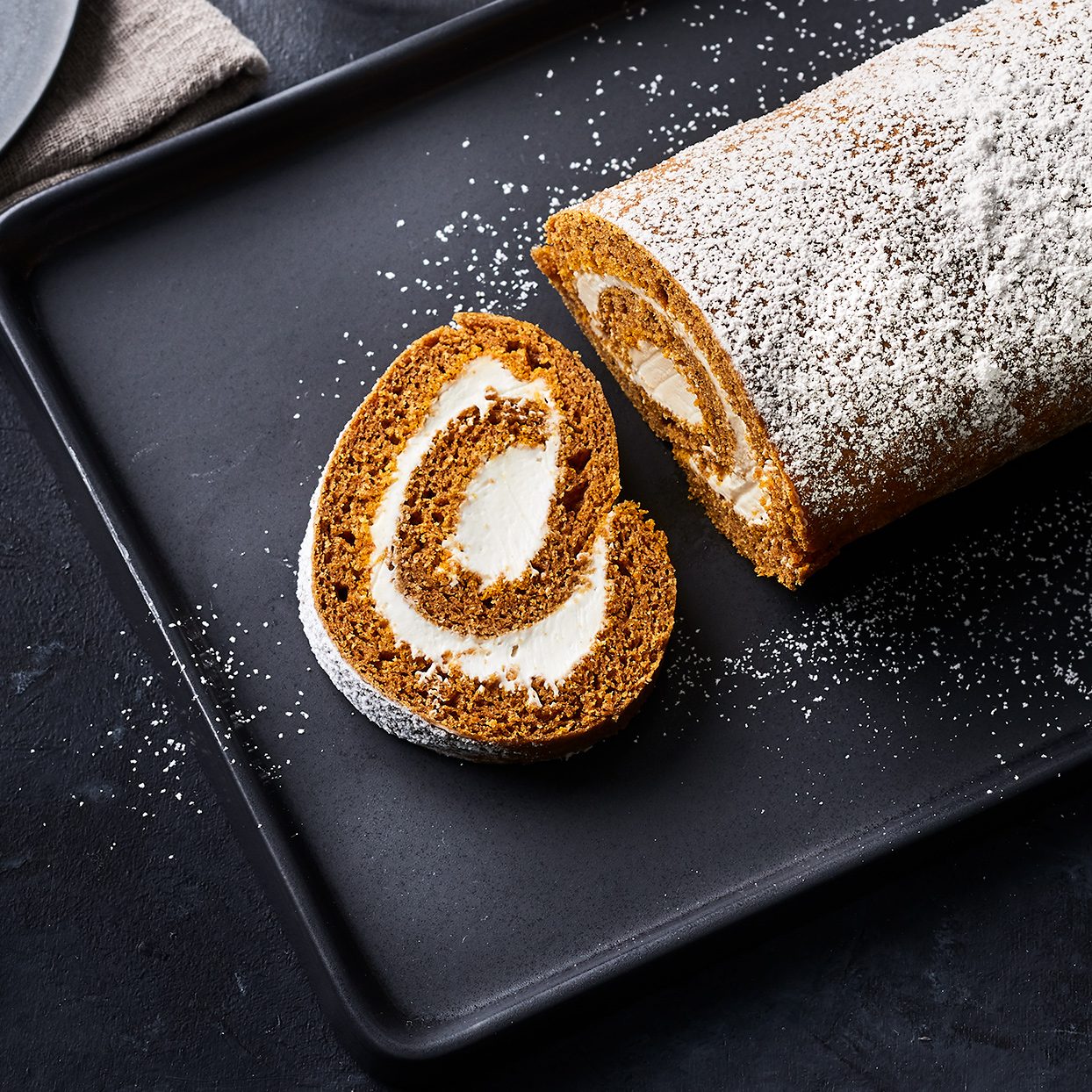Deliciously warm spiced cake layers are rolled together with slightly tangy cream cheese frosting. This pumpkin jelly roll tastes decadent, but each serving is under 200 calories and has less than 20 grams of sugar. Don't be intimidated by this jelly roll--so long as you work quickly while the cake is warm, it's hard to mess it up or crack the cake.