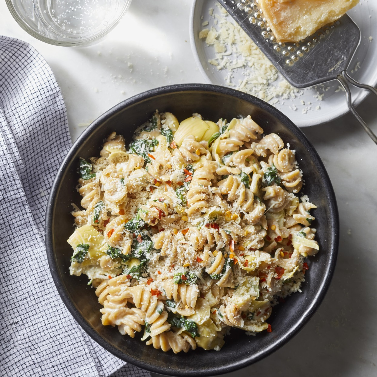 If you've ever wanted to make a meal out of warm spinach and artichoke dip, this creamy pasta is for you. And here's what's almost as good as the flavor of this comforting dish: the fact that this healthy dinner takes just 20 minutes to prepare. Source: EatingWell.com, September 2019