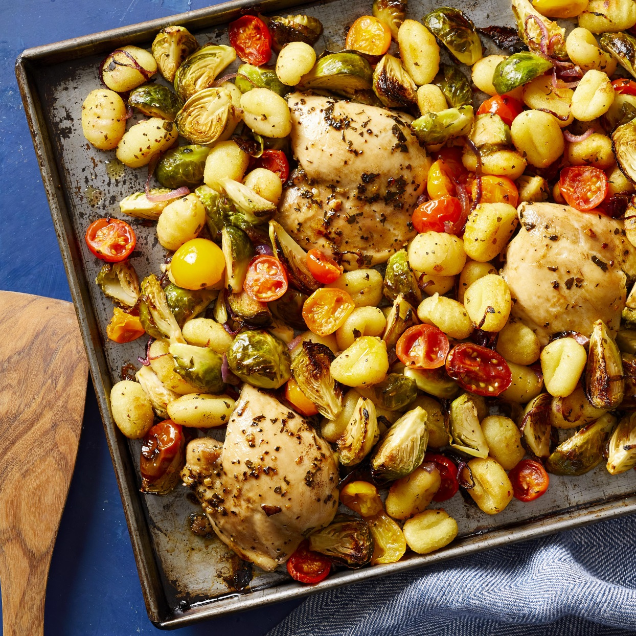 In this healthy dinner recipe, chicken thighs, Brussels sprouts, cherry tomatoes and packaged gnocchi are all roasted on the same sheet pan for a complete meal that couldn't be easier to make. And though it's simple, this dish gets tons of flavor from Mediterranean seasonings, including garlic, oregano and red-wine vinegar. It all adds up to a dish that's ready to go into heavy weeknight rotation in your house.
