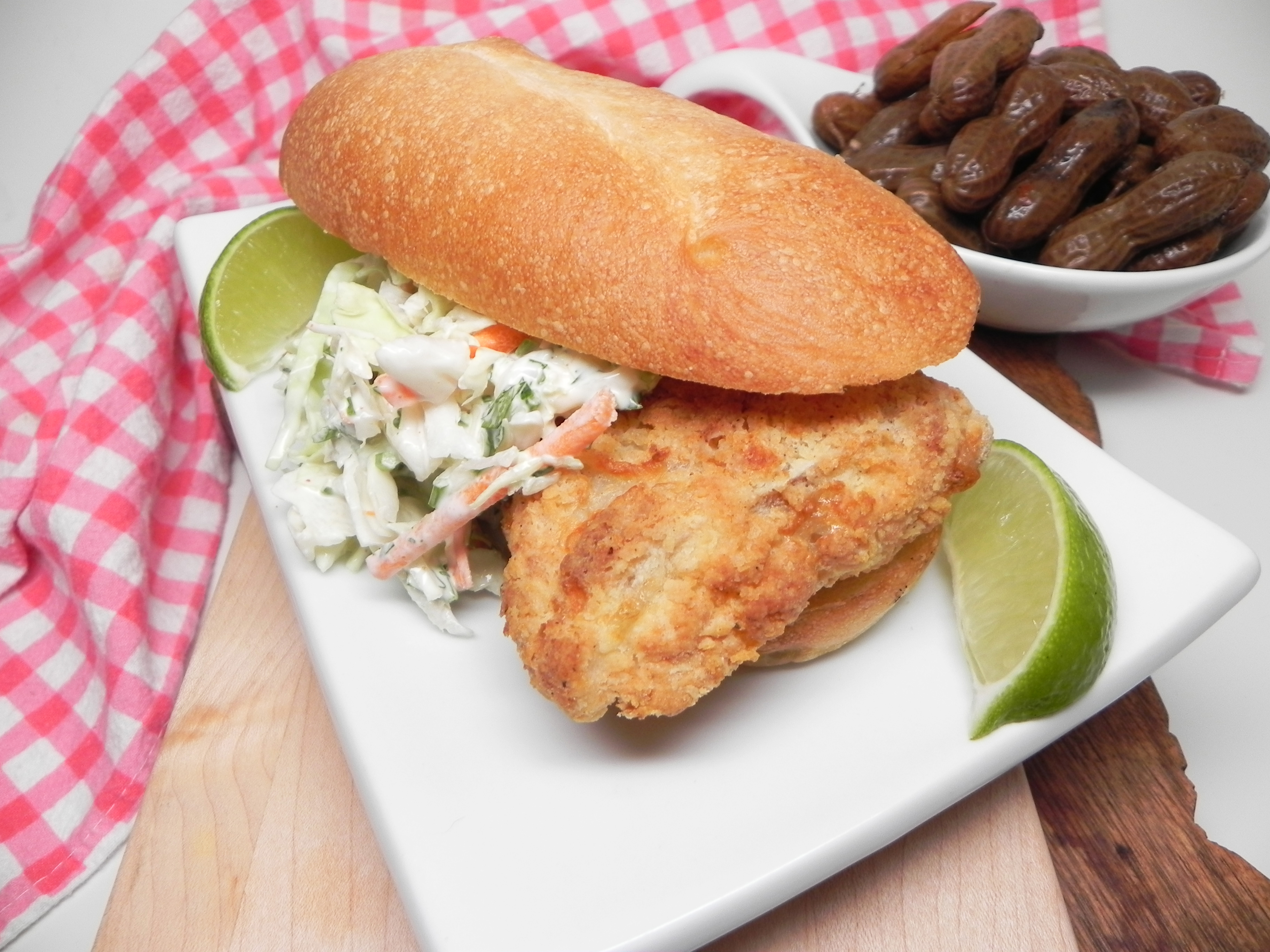 """Crispy air-fried white fish are topped with chipotle coleslaw and served on toasted hoagie rolls. """"These turned out great,"""" raves Soup Loving Nicole. """"The chipotle and cilantro in the slaw was a nice change. Bonus is that the leftover fish stayed crispy in the fridge overnight, which is something you will not get with a deep fry."""""""