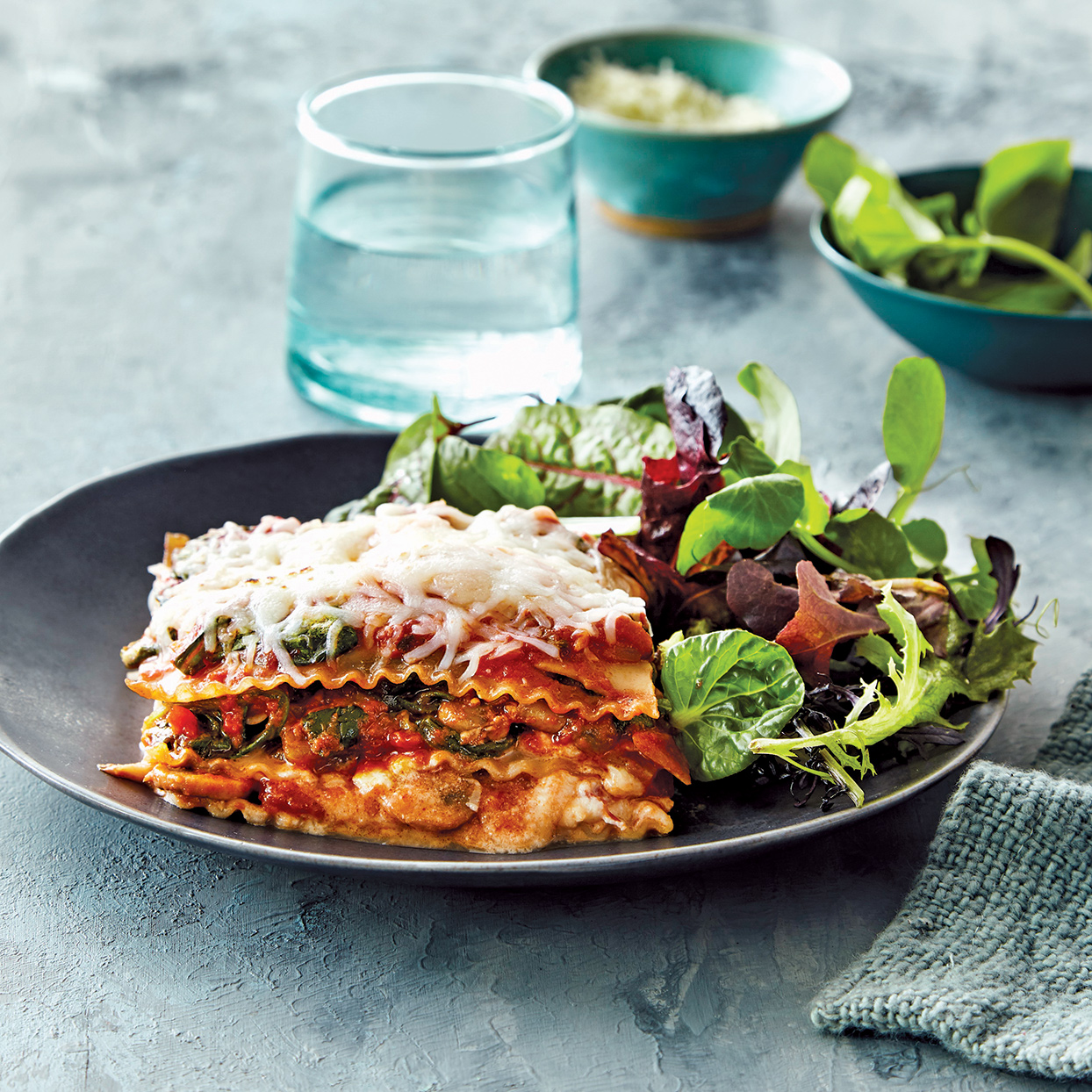 Cooking lasagna in your slow cooker rather than in the oven keeps it super moist and cheesy--just like lasagna should be. You can easily assemble this dish in the slow cooker ahead of time and refrigerate it. Just be sure to let the slow cooker come to room temperature before starting it so that the cook time is accurate. Serve with a green salad, if desired. Source: Everyday Slow Cooker