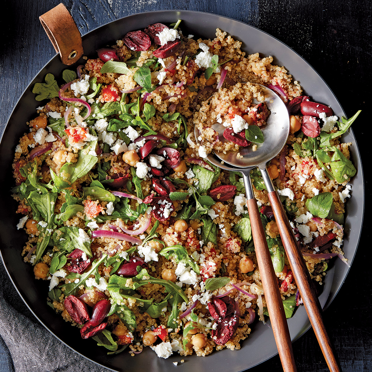 Chock-full of quinoa, chickpeas and vegetables, this salad is a meal in itself. The roasted red peppers, lemon, olives and feta add familiar Mediterranean flavor. If you want to provide a meat option, serve with grilled chicken.
