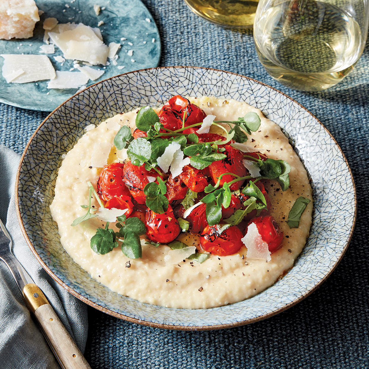 Searching for an easy yet elegant dinner-party dish? This recipe is for you. The lightly charred cherry tomatoes (you can also use grape tomatoes) are not only a vivid topping but also add sweet smokiness that complements the polenta.