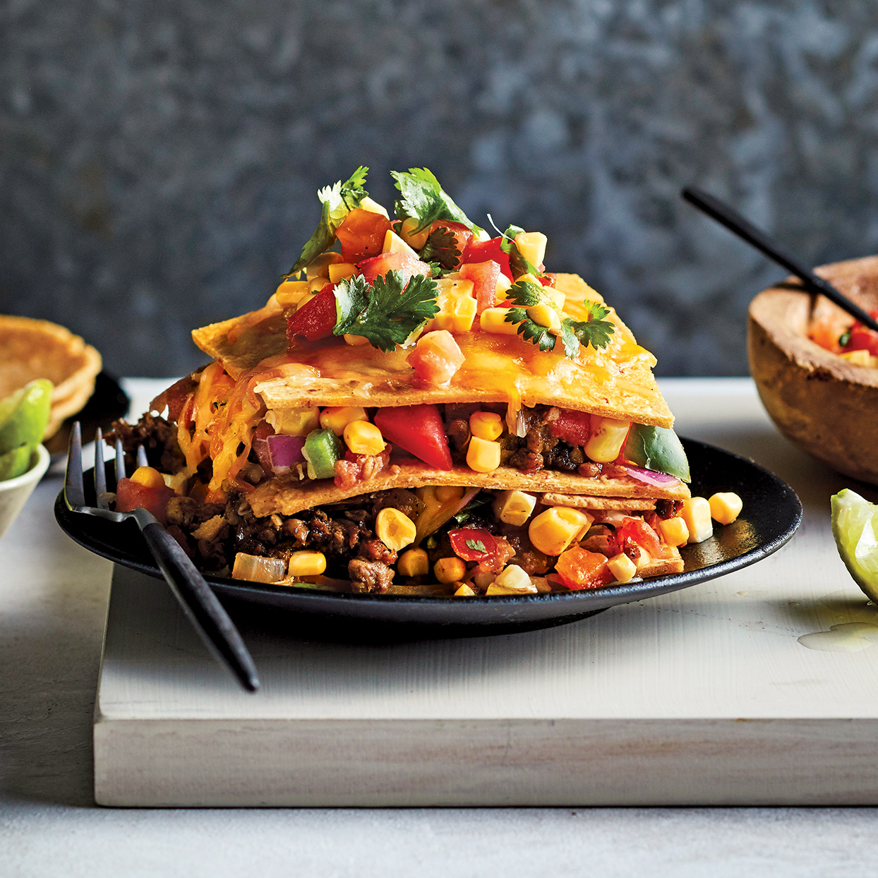 You won't believe this enchilada-like casserole isn't made with meat! The smoky chili powder and cumin give it a satisfying meat-like flavor. Look for meatless crumbles in the produce section of the supermarket near the other vegetarian and vegan products. For a twist, swap the meatless crumbles for black beans or ground beef.