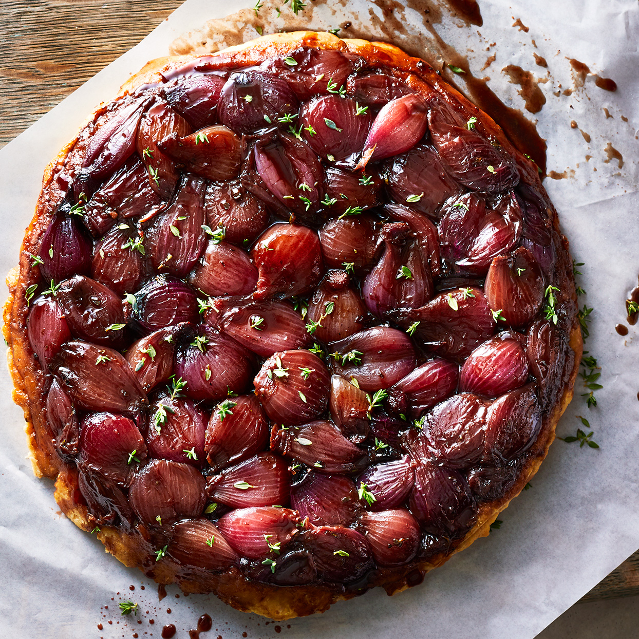 This tarte tatin hits that irresistible sweet-and-sour combo: sweet comes from roasty onions, balsamic and a touch of sugar; vinegar lends sour notes. The series of reductions intensify the flavors and create what is basically a pan sauce. Serve a slice of this tarte tatin with a salad for a light meal or alongside your favorite cut of beef for a heartier dinner.